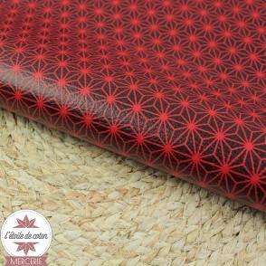 Simili cuir fin étoilé noir - fond rouge - coupon 50 x 70 cm