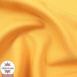 Tissu crêpe polyester uni jaune kumquat