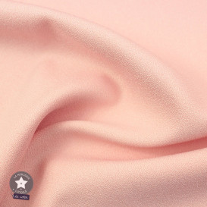 Tissu crêpe polyester uni rose clair