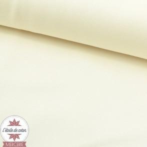Tissu crêpe polyester uni écru