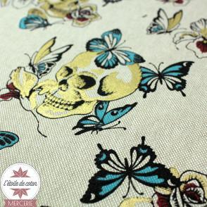 Tissu toile polycoton Tête de mort & papillon - bleu/or