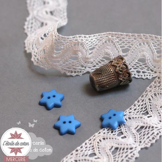 Bouton bleu forme d'étoile
