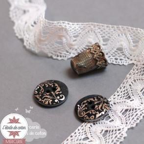 Bouton noir arabesques argentées
